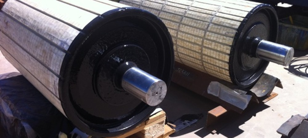 Coating conveyor pulleys for protection and longevity