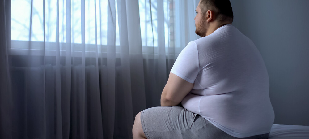 How is obesity linked to the brain?